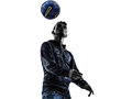 Young man soccer freestyler player silhouette one in on white background Royalty Free Stock Photography
