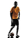 Young man soccer player silhouette one orange jersey in on white background Stock Images