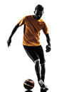Young man soccer player silhouette one orange jersey in on white background Stock Photos