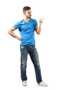 Young man solving problems with pointed index finger full body length isolated over white background Royalty Free Stock Photos