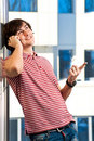 Young man speaking on cellphone Royalty Free Stock Photos