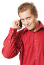 Young man speaks by a mobile phone isolated on the white Royalty Free Stock Image