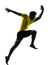 Young man sprinter runner running silhouette one caucasian in studio on white background Royalty Free Stock Photo