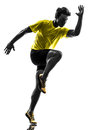 Young man sprinter runner running silhouette one caucasian in studio on white background Stock Photos