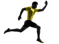 Young man sprinter runner running silhouette one caucasian in studio on white background Stock Images