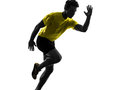 Young man sprinter runner running silhouette one in studio on white background Royalty Free Stock Photo