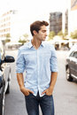 Young man standing outdoor looking away Stock Photos