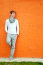 Young man standing by the wall cool orange Royalty Free Stock Photos