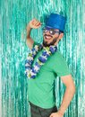 Young man stands in profile and with hand on brim of hat. Bearde Royalty Free Stock Photo