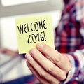 Young man with a sticky note with the text welcome 2016 Royalty Free Stock Photo