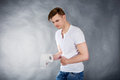 Young man with stomach issues holding toilet paper Royalty Free Stock Photos