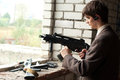Young man with submachine gun in unfinished building Royalty Free Stock Photos