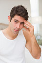 Young man suffering from headache in bed portrait of a at home Stock Image