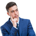 Young man in suit looking aside close up portrait of wondering business student isolated on white background Royalty Free Stock Photography