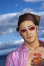 Young Man With Sunglasses and Headscarf Stock Photos