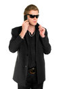 Young man in sunglasses with a phone Royalty Free Stock Photo