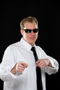 Young man in sunglasses portrait of a male model wearing a white shirt black necktie and dark shot on a black background using Royalty Free Stock Images