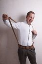 Young man with suspenders prankster having fun braces Royalty Free Stock Images