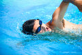 Young man swimming the front crawl Royalty Free Stock Photo