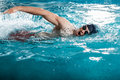 Young man swimming  in a pool Royalty Free Stock Photo