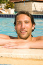 Young man in the swimmingpool Stock Photography