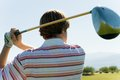 Young Man Swinging Golf Club Royalty Free Stock Image