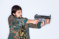 Young man taking aim bearded wearing camouflage clothes is isolated on white Royalty Free Stock Image