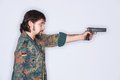 Young man taking aim bearded wearing camouflage jacket at a target isolated on white Stock Photos