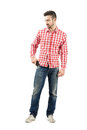 Young man taking mobile phone from his pocket fashionable full body length portrait isolated over white background Stock Photos
