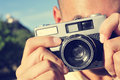 Young man taking a picture with an old camera Royalty Free Stock Photo