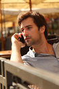 Young man talking on a mobile phone close up of enjoying in cafe Stock Photos