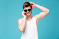 Young man talking on phone isolated over blue Royalty Free Stock Photo