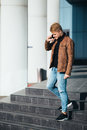 Young man talking on the phone, using smartphone, making a call. Royalty Free Stock Photo