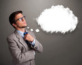 Young man thinking about cloud speech or thought bubble with cop good looking copy space Royalty Free Stock Photo