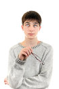 Young man thinking in sweater is isolated on the white Royalty Free Stock Image