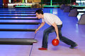 Young man throws ball in bowling Royalty Free Stock Images