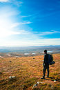 Young man at the top  looking out over the view Royalty Free Stock Photo
