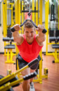Young man training on gym equipment pulling handle cables Royalty Free Stock Photos