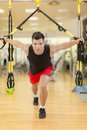 Young man training in the gym handsome Stock Images