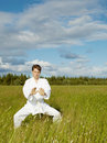 Young man is training in Wushu Stock Photo