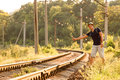 Young Man in Travel Clothing hitch hiking Railroad Train