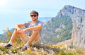 Young man traveler relaxing with mountains on background hiking and healthy lifestyle concept Royalty Free Stock Images