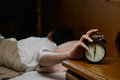 Young man turning off the alarm clock Royalty Free Stock Photo