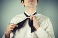 Young man tying a bow tie is showing how to formal Royalty Free Stock Photo