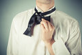Young man tying a bow tie is showing how to formal Royalty Free Stock Photography