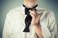 Young man tying a bow tie is showing how to formal Royalty Free Stock Image