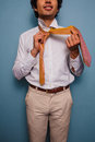Young man tying his tie happy is Royalty Free Stock Images