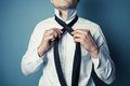 Young man tying his tie a is showing how to a necktie Royalty Free Stock Image