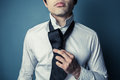 Young man tying his tie a is showing how to a necktie Stock Photography