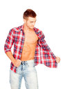 Young man with unbuttoned plaid shirt isolated on white background Royalty Free Stock Photography